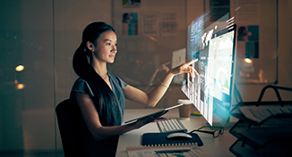 Image of Person reading data on computer screen