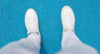 Image of Person's feet, wearing white shoes