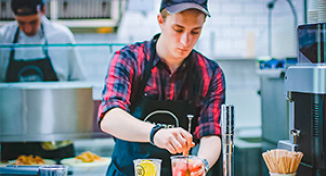 Image of Cafe worker making drinks